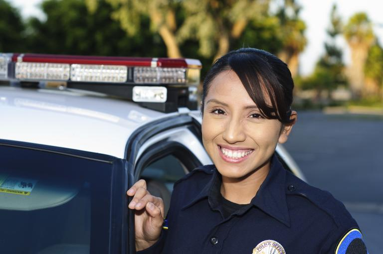 A Criminal Justice graduate serving as a police officer.