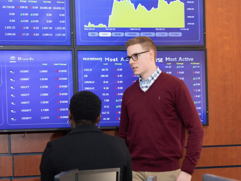 Students learning in Mercy trading room