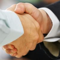 Handshake between Human Resource Manager and job candidate.